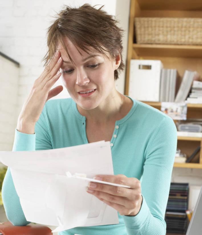 Woman Confused by Auto Insurance Papers